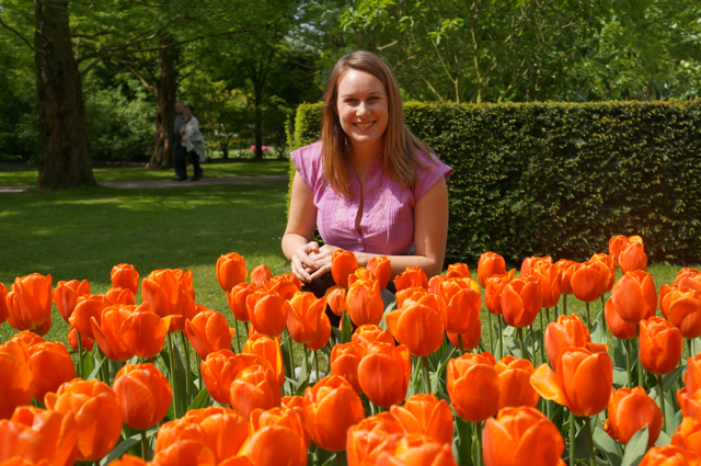 Lauren with orange tulips in Holland