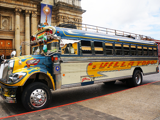 reasons to visit guatemala city- chicken bus