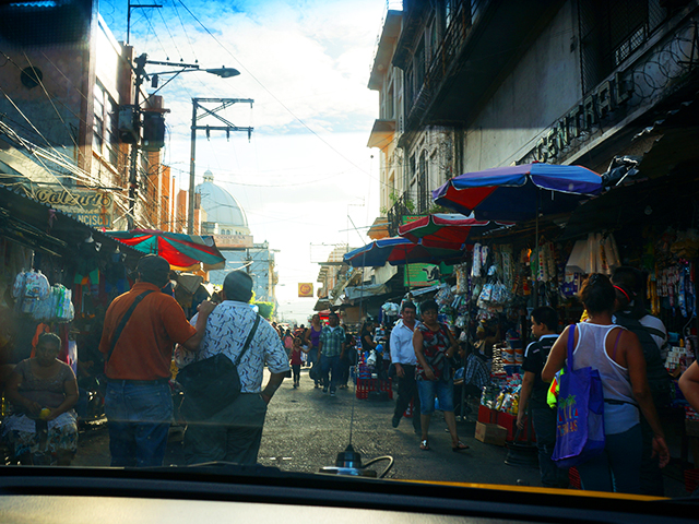traveling alone in el salvador- through the window of a taxi