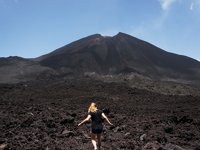 walking along the rocks at pacaya volcano