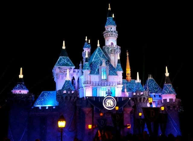 celebrating disneyland 60 anniversary in photos castle at night