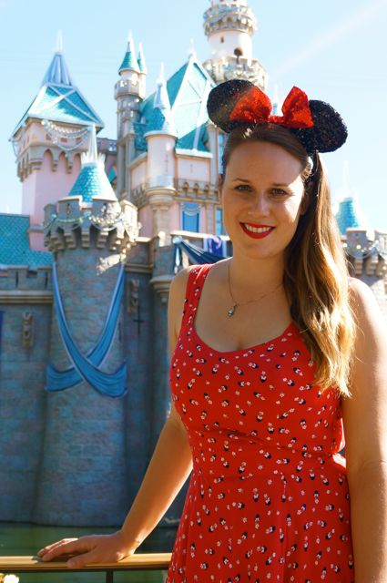 celebrating disneyland 60th anniversary in photos minnie mouse dress