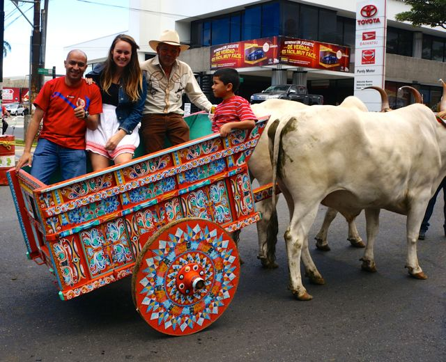 lauren in an oxcart at the san jose oxcart parade